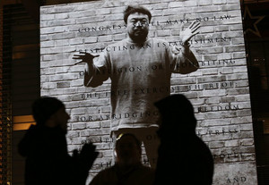 An image of Chinese artist and activist Ai Weiwei is seen projected at the Newseum on January 17, 2013 in Washington, DC