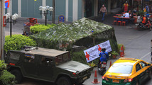 Army checkpoints in Bangkok get flowery makeover