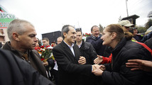 Bulgarian PM Oresharski is greeted by a supporter during a rally in central Sofia