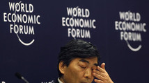 Naoyuki Shinohara, deputy managing director of the International Monetary Fund (IMF), wipes his eye during an interactive session of Rethinking State-led Growth in the World Economic Forum in Jakarta