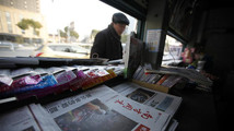 A stack of the Southern Weekly is left on display at a newsstand in Changzhou