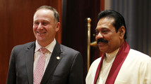 New Zealand's PM Key poses for a photo with Sri Lanka's President Rajapaksa during a banquet dinner for CHOGM in Colombo