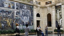 People look at a mural by artist Diego Rivera at the Art Institute of Detroit in Detroit
