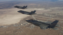 Three F-35 Joint Strike Fighters (rear to front) AF-2, AF-3 and AF-4, fly over Edwards Air Force Base, December 10, 2011.