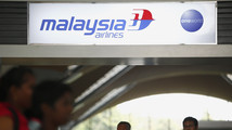 ANALYSIS-Freescale loss in Malaysia tragedy leads to travel policy questions