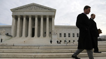 People walk outside the U.S. Supreme Court in Washington