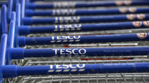 Trolleys are stacked outside a Tesco store in Hammersmith, west London