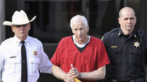 Jerry Sandusky leaves the Centre County Courthouse after his sentencing in his child sex abuse case in Bellefonte