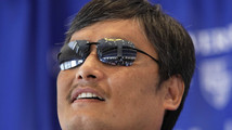 Chinese dissident Chen Guangcheng speaks at a news conference at the National Press Club in Washington