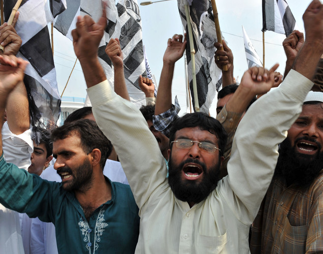 Activists of Jamaat-ud-Dawa Pakistan shout slogans during a rally following congregational Friday prayers  to denounce the resumption of NATO supplies from the country into Afghanistan.