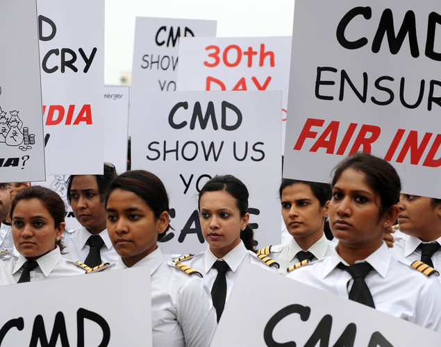 Members of the Indian Pilots' Guild participate in a silent protest march on the 30th day of their strike in Mumbai.