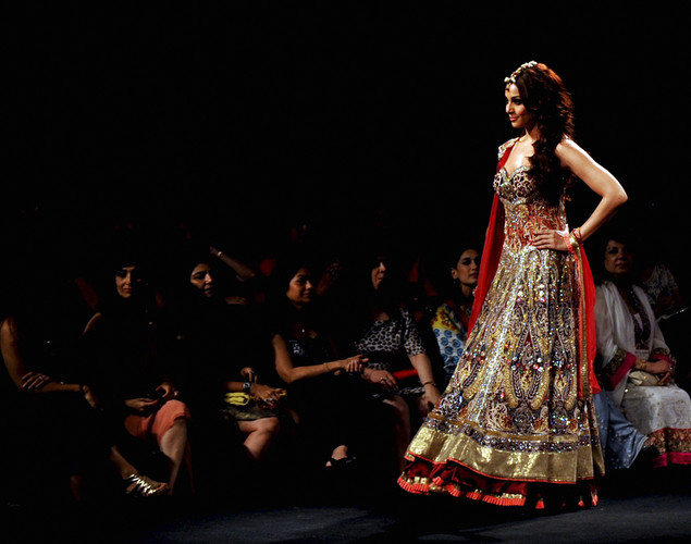 Bollywood actress Bipasha Basu walks the ramp with a creation by Anjalee and Arjun Kapoor during the Aamby Valley India Bridal Fashion Week in Mumbai.