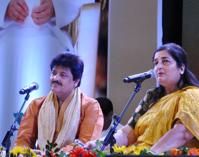 Udit Narayan (L) and Anuradha Paudwal perform during the commemoration by the Sri Sathy Sai Seva Organization Maharashtra and Goa of the first Maha Samadhi anniversary of Bhagawan Sri Sathya Sai Baba in Mumbai.