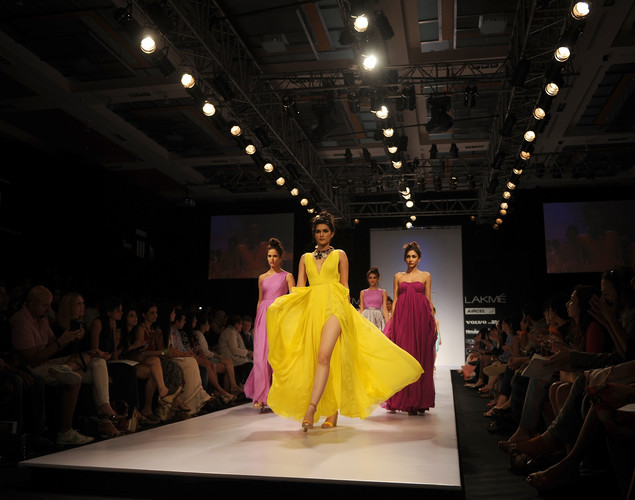 Models showcase creations by designer Drashta on the second day of Lakme Fashion Week (LFW) winter/festive 2012 in Mumbai on August 4, 2012.