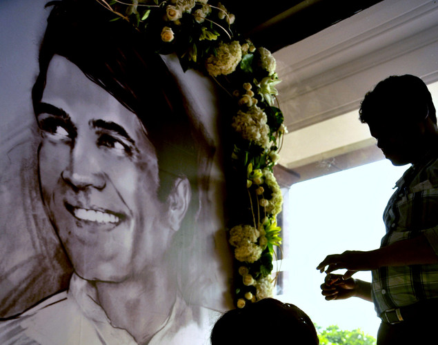 Well-wishers light candles in front of a portrait of late Indian Bollywood actor Rajesh Khanna during a prayer meet in Mumbai.
