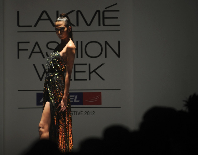 A model showcases a creation by designers Vizyon on the first day of Lakme Fashion Week (LFW) Winter/Festive 2012 in Mumbai on August 3, 2012.
