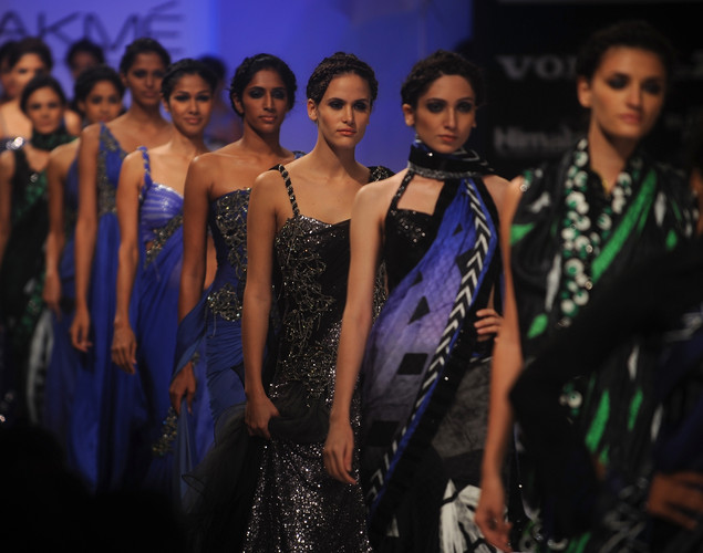 Models showcase creations by designer Archana Kochhar on the final day of Lakme Fashion Week (LFW) winter/festive 2012 in Mumbai on August 7, 2012.