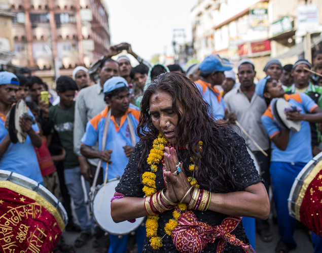 Sufi Muslim pilgrim, Basanti Hijra, 42, who walked from Delhi as part of the pilgrimage, clasps her hands as she dances during the annual procession during the 'Urs' Festival.