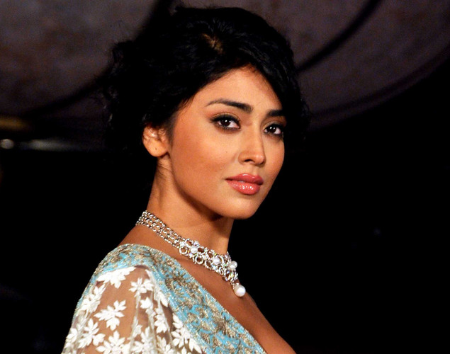 Shriya Saran displays a creation by designer Manish Malhotra for a public awareness campaign Save and Empower the Girl Child in Mumbai.
