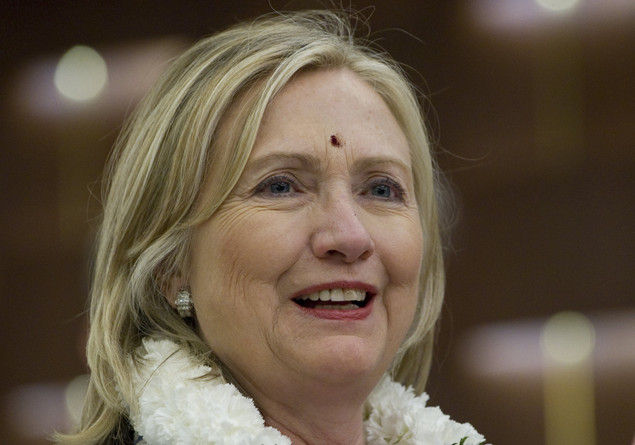 US Secretary of State Hillary Clinton, with a 'bindi' painted on her forehead, arrives at her hotel in Chennai on July 20, 2011.