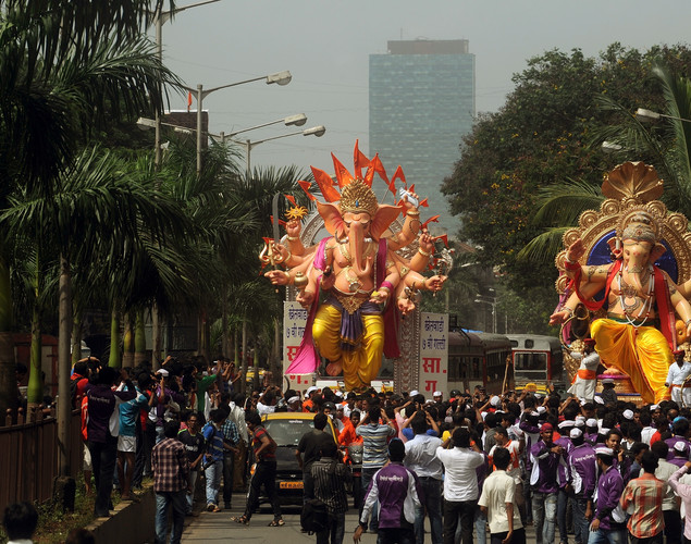 Indian Hindus carry huge idols of the elephant-headed Hindu god Lord Ganesha through the streets of Mumbai.