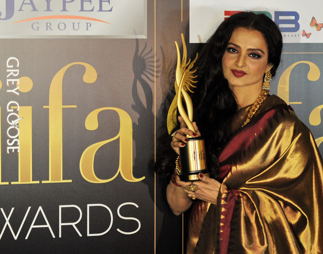 Bollywood actress Rekha , winner of the of the Life Achievement Award poses with her trophy during the International Indian Film Academy (IIFA) awards in Singapore.