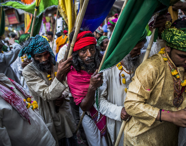 Sufi Muslim pilgrims carry flags as they march towards the 'durgah' or shrine, where Muhammad Moin-ud-din Chisti is buried, during the annual 'Urs' procession.