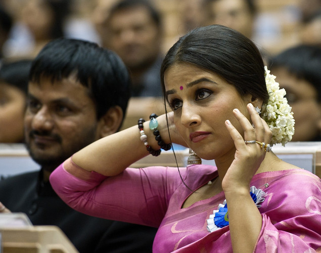 Vidya Balan (R) and Actor Girish Kulkarni listen to a speech during the 59th National Film Award in New Delhi.