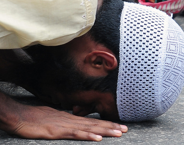 A Sri Lankan Muslim man takes part in Friday noon prayers in Colombo on April 27, 2012.
