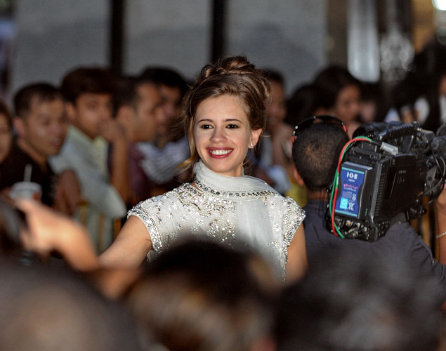 Kalki Koechlin (L), an Indian film actress of French descent arrives on the green carpet for the International Indian Film Academy (IIFA) World Premier, Shanghai, at the Lido cinema in Singapore.