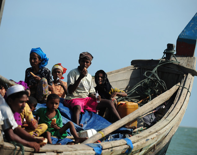 Rohingya Muslims fleeing sectarian violence try to cross the Naf river into Bangladesh in Teknaf.