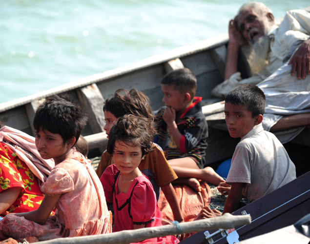 Rohingya children look on as they try to cross the Naf river in Teknaf.