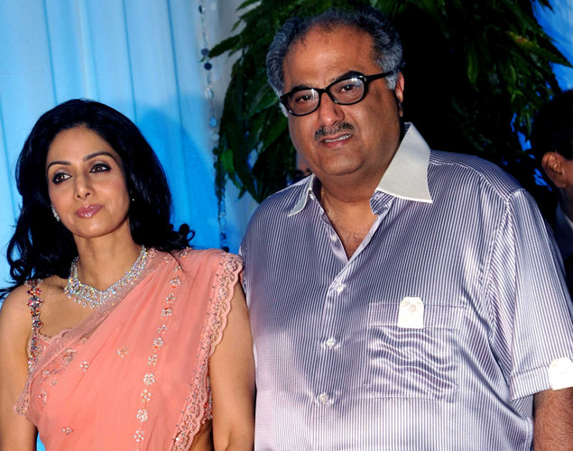 Bollywood film actress Shridevi (L) and her husband Boney Kapoor pose during the wedding reception of film actress Esha Deol and husband Bharat Takhtani in Mumbai on June 30, 2012.