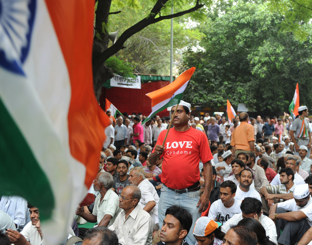 A supporter of anti-corruption activist Anna Hazare waves the Indian national flag gather during a rally where Hazare began his hunger strike in New Delhi.