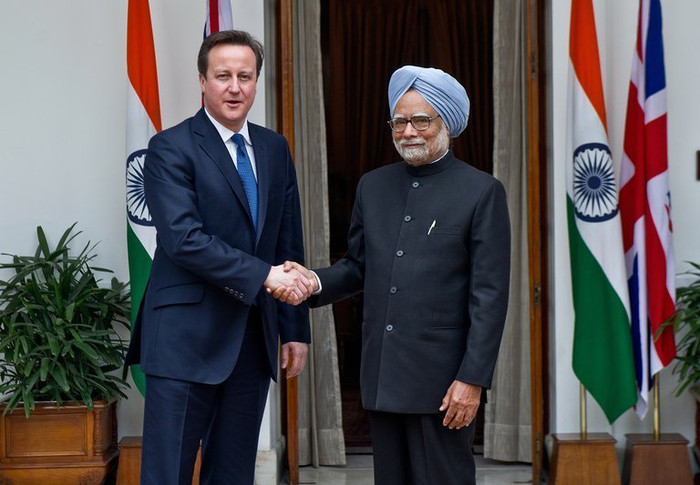 British Prime Minister David Cameron (L) shakes hands with his Indian counterpart Manmohan Singh in New Delhi on February 19, 2013.