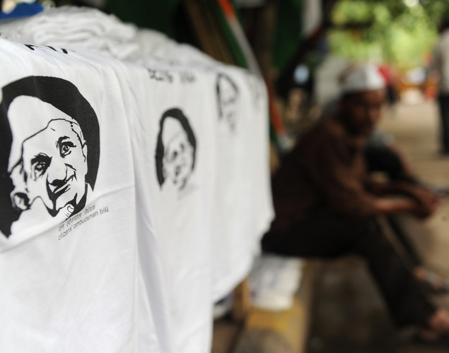 An Indian vendor sells shirts with pictures of anti-corruption activist Anna Hazare  on a road side  during a protest in New Delhi.
