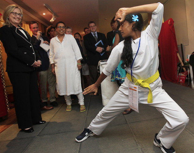 Us Secretary of State Hillary Clinton (L) watches a demonstration of karate during an Anti-Human Trafficking event in Kolkata.