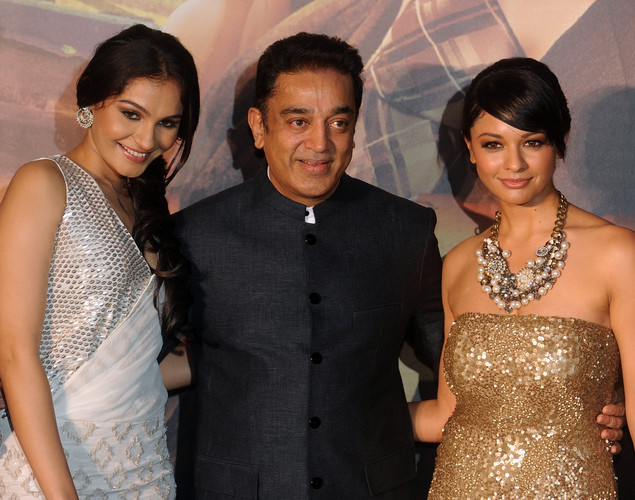 Indian actor Kamal Haasan (C) poses with co-stars after arriving at the green carpet to attend the premier of the new movie 'Shanghai' during the International Indian Film Academy (IIFA) awards event, in Singapore.