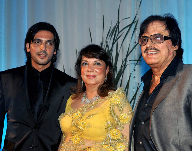 Bollywood film actor Sanjay Khan (R), wife Zarine (C) and son Zayed Khan pose during the wedding reception of film actress Esha Deol and husband Bharat Takhtani in Mumbai.
