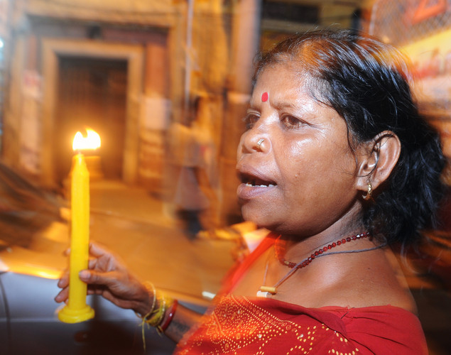 An Indian sex worker holds a candle as marches in a May Day rally asking for their rights and the recognition of their profession on the eve of the International Labor Day, in Kolkata on late April 30, 2012.