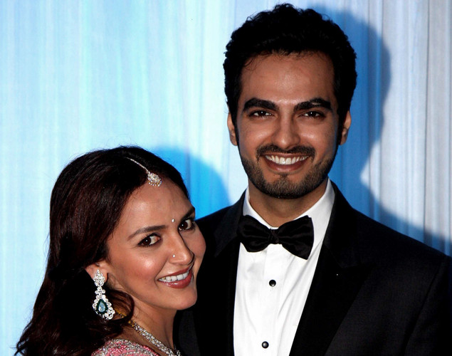 Bollywood film actress Esha Deol (L) poses with husband Bharat Takhtani at their wedding reception ceremony in Mumbai.