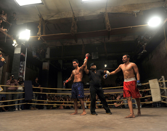 Indian student, judo practitioner and mixed martial arts (MMA) fighter Aditya Despande (L) is declared winner after his bout of the FCC (Full Contact Championship) 6 fight night in Mumbai.