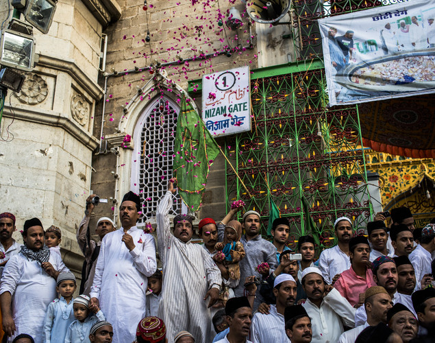 Rose petals are thrown in to the air as Sufi Muslim pilgrims arrive to the 'durgah' or shrine, where Muhammad Moin-ud-din Chisti is buried during the annual 'Urs' procession.
