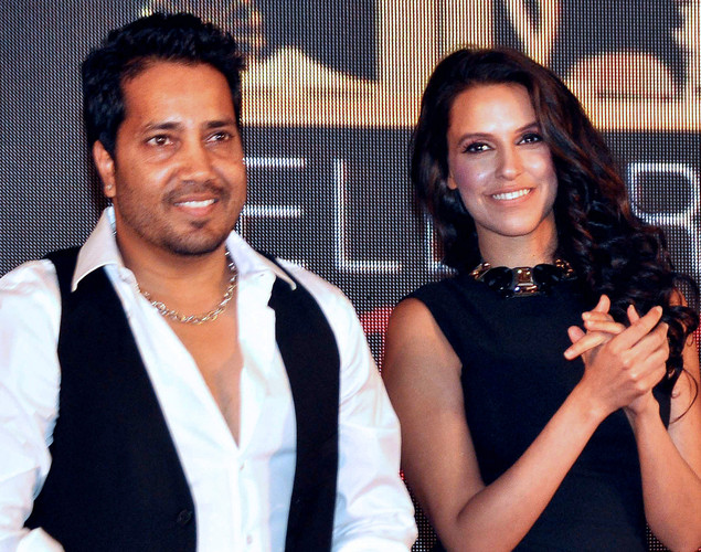 Neha Dhupia (R) and playback singer Mikka Singh attend the press conference for the announcement of the 'IIFA Awards 2012' ceremony in Mumbai.