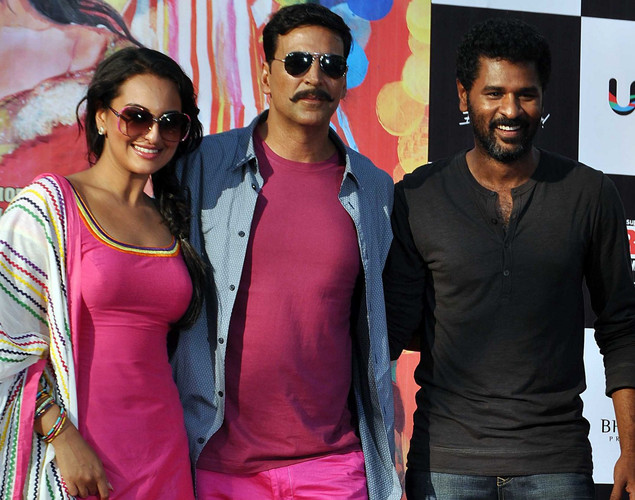 Akshay Kumar (C) and Sonakshi Sinha (L) pose for a photo with director Prabhu Deva  during a promotion for the  upcoming Hindi film Rowdy Rathore in Mumbai.
