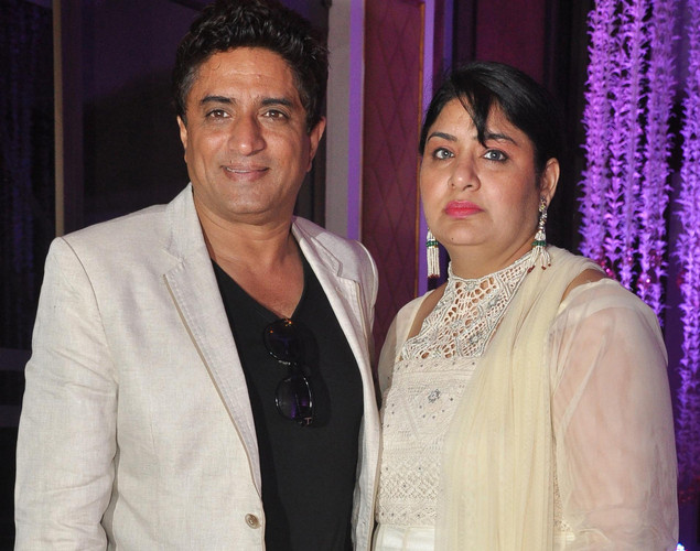 Bollywood music director Anand Raj Anand with wife attend the wedding reception of playback singer Sunidhi Chauhan and musician Hitesh Sonik.