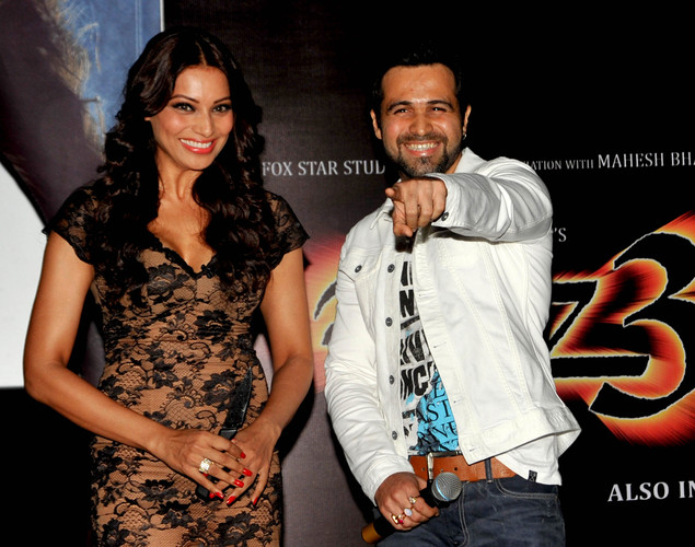 Bollywood film actors Bipasha Basu (L) and Emraan Hashmi pose during the launch of the first trailer of upcoming Hindi horror thriller film 'Raaz 3' directed by Vikram Bhatt in Mumbai.