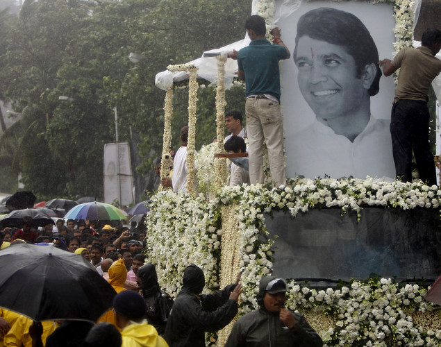 Mourners gather around as the body of Bollywood superstar Rajesh Khanna is taken in a truck during his funeral in Mumbai, India.