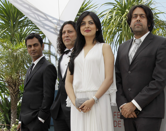 Nawazuddin Siddiqui, Anil George, Niharika Singh and director Ashim Ahluwalia pose during a photo call for Miss Lovely at the 65th international film festival, in Cannes, southern France.