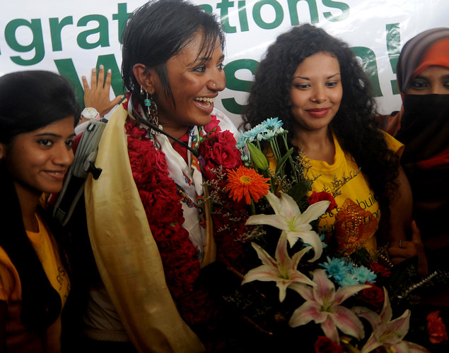 Bangladeshi mountaineer Wasfia Nazreen (2L) poses for a photo with fans after arriving at the Hazrat Shahjalal International Airport in Dhaka.